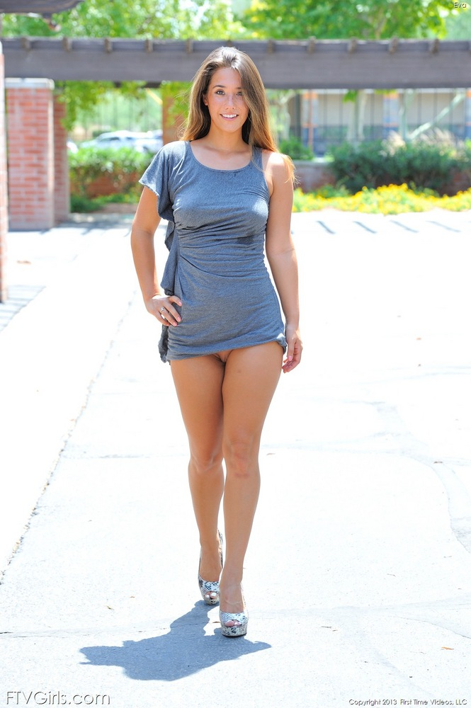 Busty brunette Eva with her short dress riding up revealing no panties