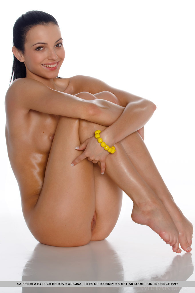 naked on the floor with her arms wrapped around her sexy bare legs 16